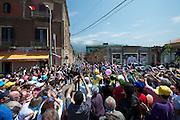 The peloton passes through the town of Sapri.