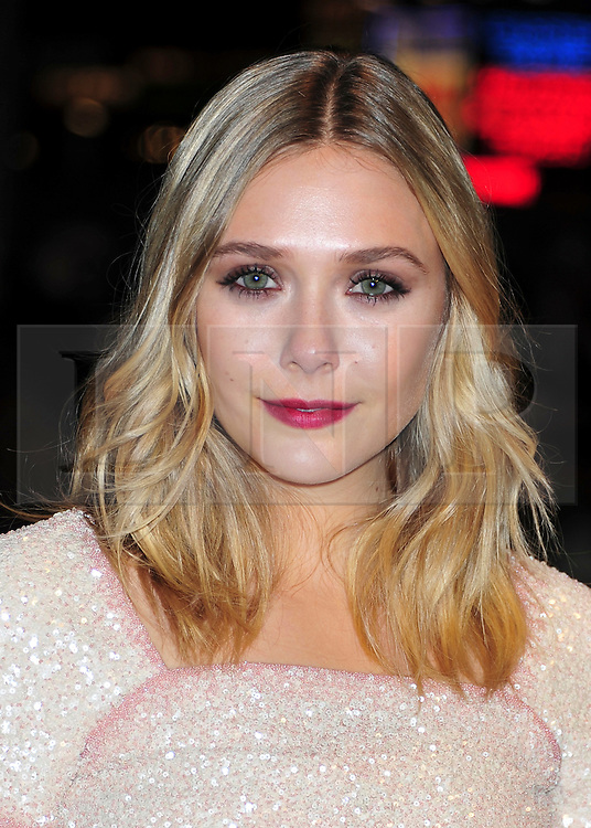 "© Licensed to London News Pictures. 21/10/2011. London,England. Elizabeth Olsen attends the UK Premiere of ""Martha Marcy May Marlene"" at  the 55th British Film Festival in Leicester square London  Photo credit : ALAN ROXBOROUGH/LNP"