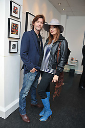 CATALINA GUIRADO and MATT CHEADLE at a private view of an exhibition of photographs by Mike Figgis entitled 'Kate & Other Women' held at The Little Black Gallery, 13 A Park Walk, London SW10 on 22nd June 2011.