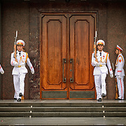Vietnamese soldiers goosestep their way to the entrance of the Ho Chi Minh Mausoleum as part of the changing of the guard ceremony. A large memorial in downtown Hanoi surrounded by Ba Dinh Square, the Ho Chi Minh Mausoleum houses the embalmed body of former Vietnamese leader and founding president Ho Chi Minh.