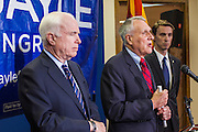 15 AUGUST 2012 - PHOENIX, AZ:    Senators JOHN MCCAIN and JON KYL announce their endorsement of Rep BEN QUAYLE, far right, Wednesday. Arizona's Republican US Senators, John McCain and Jon Kyl, announced their endorsement of Congressman Ben Quayle (R-AZ) during a press conference in Phoenix Wednesday. They decried the campaign being run by Quayle's opponent, Congressman David Schweikert (R-AZ). Both Quayle and Schweikert are freshman Congressmen from neighboring districts. They were thrown into the same district during the redistricting process and are now waging a bitter primary fight against each other.   PHOTO BY JACK KURTZ