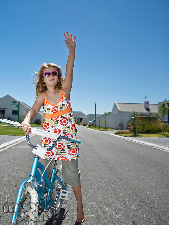 South Africa Cape Town girl standing on street with  bicycle and waving