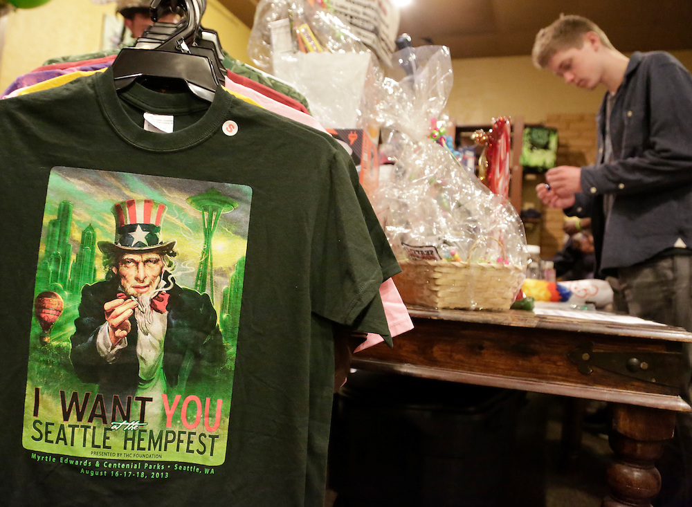 T-shirts and other merchandise are pictured at the Seattle Hempfest 4/20 event in Seattle, Washington April 20, 2014. Thousands of marijuana enthusiasts gathered inColoradoand Washington state over the weekend for an annual celebration of cannabis culture with rallies, concerts and trade shows in the first two states to legalize recreational marijuana. REUTERS/Jason Redmond (UNITED STATES)