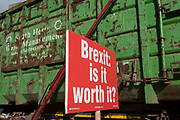 A refuse lorry passes a placard asking about the value of a Brexit, attached by pro-Europe anti-Brexit protesters to railings opposite the British Houses of Parliament in Westminster, on 16th October 2018, in London, England.