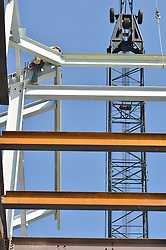 View up through floors at West Elevations during steel erection Central Connecticut State University. New Academic Building. CT-DCS Project No: BI-RC-324 Architect: Burt Hill Kosar Rittelmann Associates. Contractor: Gilbane, Inc.