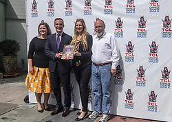 July 24, 2017 - Los Angeles, California, U.S - Los Angeles Mayor Eric Garcetti, l2nd eft, receives the first commemorative, full-color souvenir book to mark the 90-year history of the TCL Chinese Theatre, on Monday, July 24, 2017, in Los Angeles (Credit Image: © Ringo Chiu via ZUMA Wire)