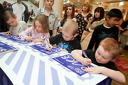 "Cadburys Spots vs Stripes Challenge Race Season Meadowhall Sheffield.Georgie and Darcie Wasnidge take on Benjamin and Thomas Tilbrook in a Boys vs Girls ""Fastest Doodler""..2 April 2011.Images © Paul David Drabble"