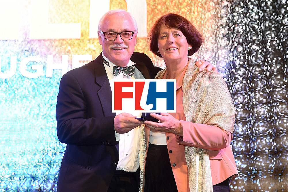 DUBAI, UNITED ARAB EMIRATES - NOVEMBER 11: Norman Hughes recieves the Etienne Glichitch Award from Marijke Fleuren at the Hockey Revolution Part 2 No Limits Ball  on November 11, 2016 in Dubai, United Arab Emirates.  (Photo by Tom Dulat/Getty Images)