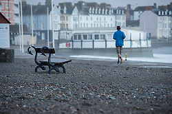 © Licensed to London News Pictures. 13/02/2014. Aberystwyth, UK At first light the impact of the previous day's 100mph winds and high tides is clear to see on the promenade at Aberystwyth on the west wales coast. . Photo credit : Keith Morris/LNP