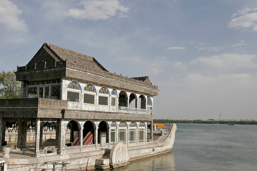 In 1888 Empress Dowager Cixi used the Naval budget to build a  marble boat that rests in Kunming Lake.  The Summer Palace in north west Beijing, China was built in the Jin Dynasty.  The Summer Palace is over 700 acres, 3/4 of which is the Kunming Lake.