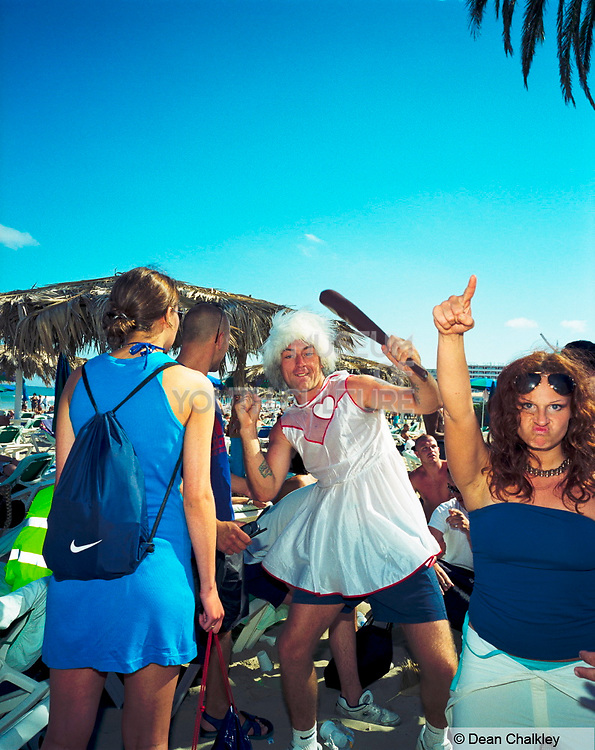 Guy in a dress holding a club, Space, Ibiza 2001