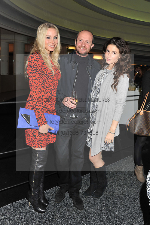 Left to right, NOELLE RENO, SCOT YOUNG and SHIRLEY LEIGH-WOOD OAKES at the launch of famed American fitness club 'Equinox' 99 High Street Kensington, London on 23rd October 2012.