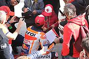 World Champion #93 Marc Marquez, Spanish: Repsol Honda Team makes time for a young fan during the Gran Premio Motul de la Comunitat Valenciana at Circuito Ricardo Tormo Cheste, Valencia, Spain on 15 November 2019.
