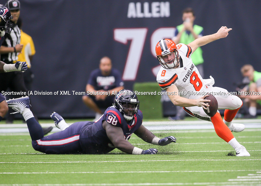 HOUSTON, TX - OCTOBER 15:  Cleveland Browns quarterback Kevin Hogan (8) avoids being tackled by Houston Texans nose tackle D.J. Reader (98) during the football game between the Cleveland Browns and Houston Texans on October 15, 2017 at NRG Stadium in Houston, Texas.  (Photo by Leslie Plaza Johnson/Icon Sportswire)