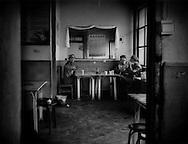Men killing time in a restaurant over tea.  Madoi, Amdo, Tibet  (Maduo. Qinghai, China)