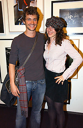 Actor HUGH DANCY and artist ANNIE MORRIS at a party to celebrate the opening of Photo-London 2006 at Burlington Gardens, London W1 on 17th May 2006.<br />
