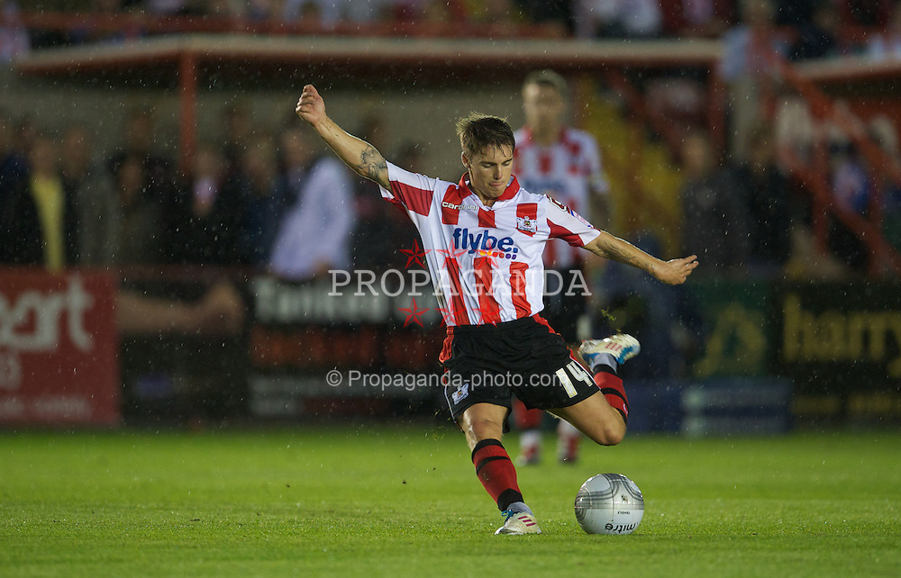 EXETER, ENGLAND - Wednesday, August 24, 2011: Exeter City's Chris Shephard in action against Liverpool during the Football League Cup 2nd Round match at St James Park. (Pic by David Rawcliffe/Propaganda)