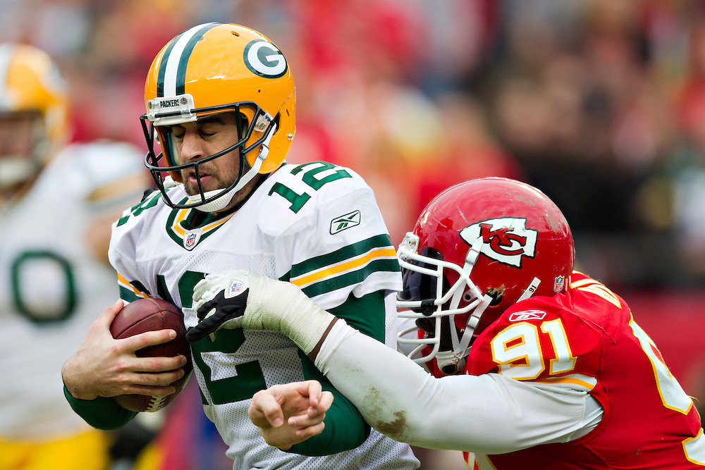 KANSAS CITY, MO - DECEMBER 18:  Aaron Rodgers #12 of the Green Bay Packers is sacked from behind by Tamba Hali #91 of the Kansas City Chiefs at Arrowhead Stadium on December 18, 2011 in Kansas CIty, Missouri.  The Chiefs defeated the Packers 19-14.   (Photo by Wesley Hitt/Getty Images) *** Local Caption *** Aaron Rodgers; Tamba Hali