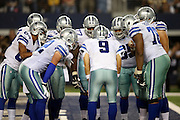 Dallas Cowboys quarterback Tony Romo (9) calls a play in the huddle as he comes back onto the field of play after getting kneed in the back earlier in the game during the NFL week 8 regular season football game against the Washington Redskins on Monday, Oct. 27, 2014 Arlington, Texas. The Redskins won the game 20-17 in overtime. ©Paul Anthony Spinelli