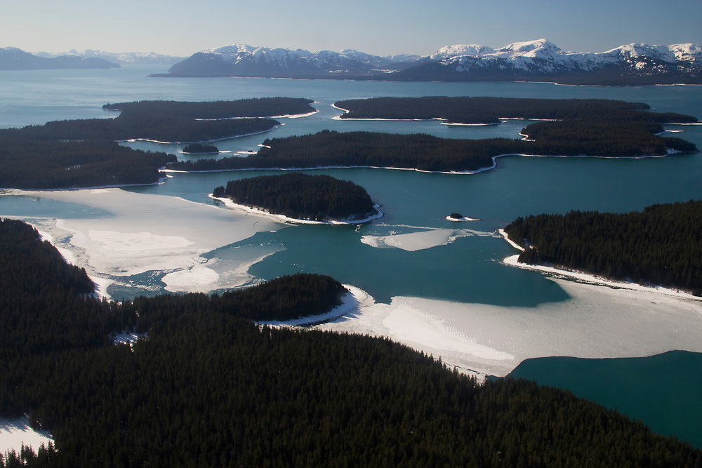 An aerial shot of the Beardslee Islands and pan ice from winter in Glacier Bay National Park.