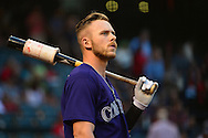 Apr 29, 2016; Phoenix, AZ, USA; Colorado Rockies shortstop Trevor Story (27) looks on from the on deck circle during the game against the Arizona Diamondbacks at Chase Field. Mandatory Credit: Jennifer Stewart-USA TODAY Sports