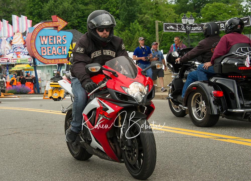 Rider on a Suzuki R GSX Sport at Weirs Beach Thursday afternoon.  (Karen Bobotas/for the Laconia Daily Sun)