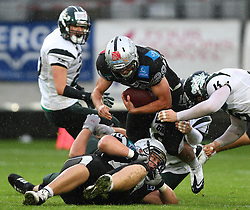 11.06.2011, Tivoli Stadion, Innsbruck, AUT, AFL Halbfinale, Swarco Raiders Tirol vs Danube Dragons, im Bild Andreas Hofbauer, (Swarco Raiders Tirol, #29, RB) wird von der Dragons Defense gestoppt,  EXPA Pictures © 2011, PhotoCredit: EXPA/ T. Haumer
