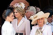 """Koning Willem Alexander wordt door Hare Majesteit Koningin Elizabeth II geïnstalleerd in de 'Most Noble Order of the Garter'. Tijdens een jaarlijkse ceremonie in St. Georgekapel, Windsor Castle, wordt hij geïnstalleerd als 'Supernumerary Knight of the Garter'.<br /> <br /> King Willem Alexander is installed by Her Majesty Queen Elizabeth II in the """"Most Noble Order of the Garter"""". During an annual ceremony in St. George's Chapel, Windsor Castle, he is installed as """"Supernumerary Knight of the Garter"""".<br /> <br /> Op de foto / On the photo: Queen Letizia , Queen Maxima , Camilla Parker Bowles"""