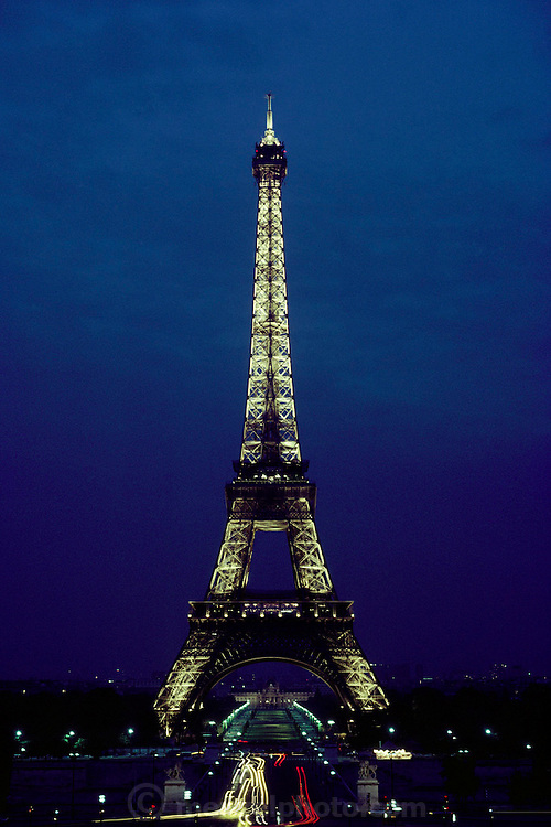 Night time time-exposure with traffic leading up to the Eiffel Tower. Paris, France.