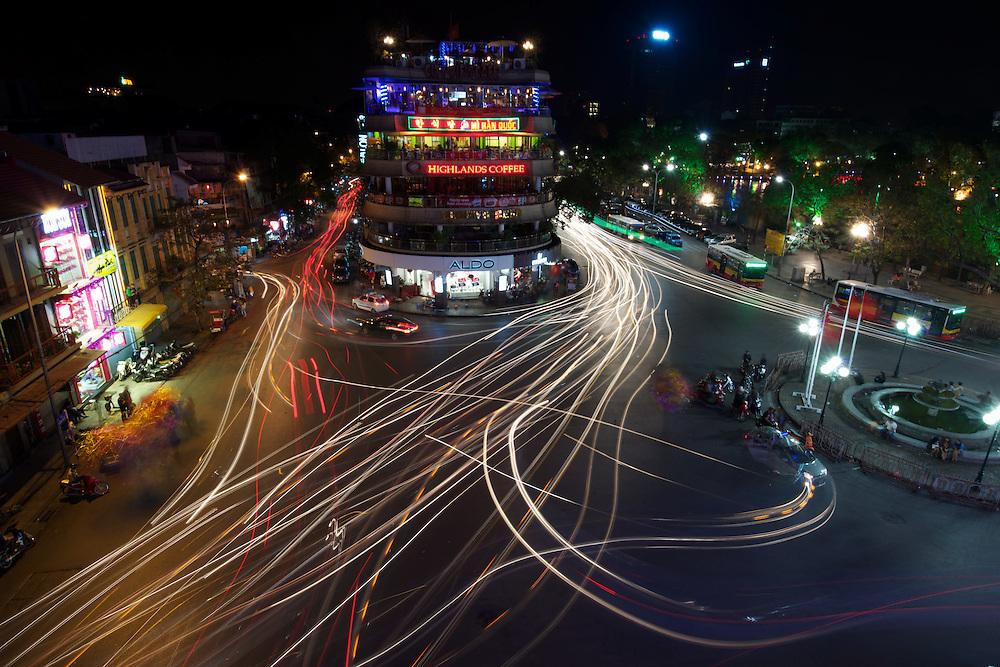 Night scene of traffic trails in the Old Quarter, overlooking Hoan Kiem Lake.