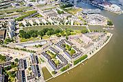 Nederland, Zuid-Holland, Rotterdam, 10-06-2015; Feijenoord. Simonsterrein aan weerszijden van de Feijenoordhaven, met bouwblokken van de sociale woningbouw op terrein van voormalig scheepssloopbedrijf Simons. Nassauhaven en hoofdkantoor Unilver.<br /> Social housing in Rotterdam-South, build on the site of a former ship demolition yard. <br /> luchtfoto (toeslag op standard tarieven);<br /> aerial photo (additional fee required);<br /> copyright foto/photo Siebe Swart