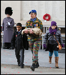 A soldier with a sand bag being loaded onto a gun carriage to be bought back to London as the The Duke of Edinburgh attends the Menin Gate in Ypres, Belgium, at a ceremony on Armistice Day to mark the gathering of soil for the Flanders Fields Memorial Garden at the Guards Museum in London, Monday, 11th November 2013. Picture by Stephen Lock / i-Images