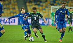 KIEV, UKRAINE - Easter Monday, March 28, 2016: Wales' Neil Taylor in action against Ukraine's captain Ruslan Rotan during the International Friendly match at the NSK Olimpiyskyi Stadium. (Pic by David Rawcliffe/Propaganda)