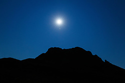Moon over mountains of Massacre Gap in the Fracked Cristobal Range, Armendaris Ranch, Ted Turner Expeditions, near Truth or Consequences, New Mexico, USA.