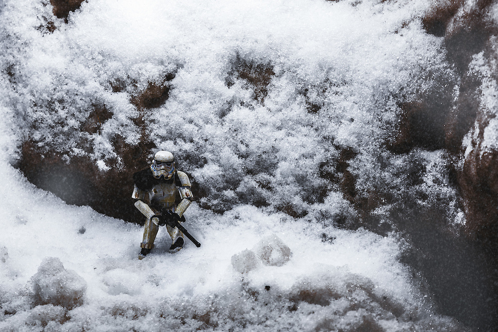 A Stormtrooper on patrol alone in the mountains during a snowstorm.