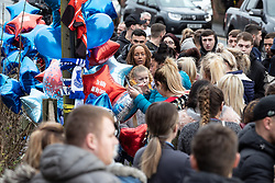© Licensed to London News Pictures . 30/12/2018 . Wigan , UK . Mourners gather at the site of Billy's murder to lay flowers , balloons and tributes . Greater Manchester Police have launched a murder investigation after 21-year-old William Livesley (known as Billy ) was murdered next to a house on Bickershaw Lane in Abram on Friday evening (28th December 2018) . Photo credit : Joel Goodman/LNP