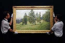 """© Licensed to London News Pictures. 02/06/2017. London, UK. Technicians present """"Summer"""", 1891, by Isaak Levitan (est. 1-1.5m).  Preview of Sotheby's sale of Russian pictures and works of art which takes place on 6 June 2017 at Sotheby's in New Bond Street. Photo credit : Stephen Chung/LNP"""