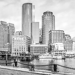 Boston Skyline harborwalk black and white panoramic picture with Rowes Wharf, downtown Boston skyscrapers and Nothern Avenue Bridge. Panoramic photo ratio is 1:3.