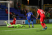 AFC Wimbledon attacker Michael Folivi (17) rounding the keeper to score goal during the Leasing.com EFL Trophy match between AFC Wimbledon and Leyton Orient at the Cherry Red Records Stadium, Kingston, England on 8 October 2019.