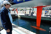 Dominique Wavre takes a look at the keel as Temenos 2 is hauled out of the water in Wellington. Barcelona World Race. 2/1/2008