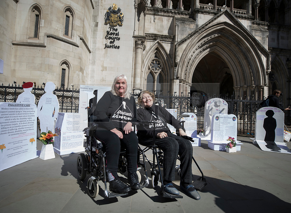 """© Licensed to London News Pictures. 01/05/2018. London, UK. Campaigners Nikki Kenward (L) and Elspeth Chowdharay protest against euthanasia at the High Court as terminally ill man Noel Conway challenges the law on assisted suicide. Mr Conway, who has motor neurone disease, is asking judges to acknowledge his """"basic right to die"""". Photo credit: Peter Macdiarmid/LNP"""