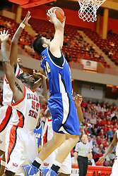 06 January 2007:Jay Tunnell spins in past Greg Dilligard for a two-handed attempt. The Sycamores of Indiana State University topped the Redbirds home 54 - 50 inside Redbird Arena in Normal Illinois on the campus of Illinois State University.<br />