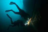 Divers investigating ship wreck, close to Svolvaer, Lofoten, Norway, Model release by photographer