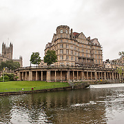 A view of central Bath from the banks of the River Avon, Somerset, United Kingdom. In the background at left is Bath Abbey.