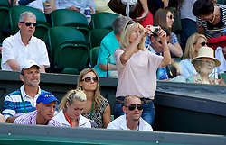 LONDON, ENGLAND - Thursday, July 3, 2014: Lucie Safarova's mother Jana takes a photo during the Ladies' Singles Semi-Final match on day ten of the Wimbledon Lawn Tennis Championships at the All England Lawn Tennis and Croquet Club. (Pic by David Rawcliffe/Propaganda)