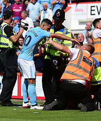 Sergio Aguero of Manchester City gets in a tussle with a steward. - Mandatory by-line: Alex James/JMP - 26/08/2017 - FOOTBALL - Vitality Stadium - Bournemouth, England - Bournemouth v Manchester City - Premier League