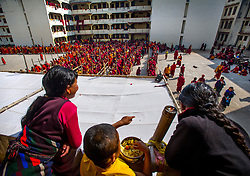 Jan. 14, 2013 - Bodh Gaya, Bihar, India - TIBETAN BUDDHISM IN EXILE..Thousands of Tibetan Buddhist Monks line up for a mid day meal during a break while on pilgrimage in Bodh Gaya, India. A religious site, Mahabodhi Temple Complex is a UNESCO World Heritage Site in Gaya district in the Indian state of Bihar., where Gautama Buddha was enlightened under the Bodi tree...Story Summary: Tibetan Buddhism is alive and well, outside of Tibet. The religion and culture of the Tibetan people is flourishing in communities around the world as exiled Tibetan spiritual leader the Dalai Lama has indicated ‰Û÷would not have happened this way if China had not scattered his people to the wind.‰Ûª After the Chinese communists invaded Tibet and severely oppressed the its people, thousands of refugees, including the Dalai Lama, fled their homeland for places such as Dharamsala, India, where many live with the Tibetan Government in exile along with, Bodhgaya, India and Kathmandu, Nepal. The culture is strong with new refugees breathing life into the old ways. Northern India is where the Buddha began his journey of enlightenment and is where much of this form of Buddhist teachings have taken hold. (Credit Image: © Eric Reed/ZUMAPRESS.com)