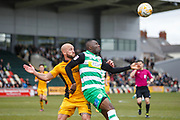 Francois Zoko of Yeovil Town and David Pipe of Newport County during the EFL Sky Bet League 2 match between Newport County and Yeovil Town at Rodney Parade, Newport, Wales on 14 April 2017. Photo by Andrew Lewis.