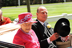 HM THE QUEEN and HRH The DUKE OF EDINBURGH at the second day of the 2010 Royal Ascot Racing festival at Ascot Racecourse, Berkshire on 16th June 2010.