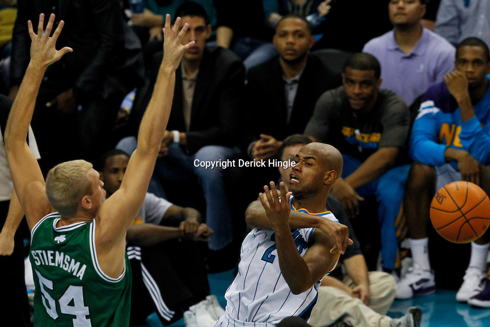 December 28, 2011; New Orleans, LA, USA; New Orleans Hornets point guard Jarrett Jack (2) passes as Boston Celtics center Greg Stiemsma (54) defends during the second quarter of a game at the New Orleans Arena. The Hornets defeated the Celtics 97-78.   Mandatory Credit: Derick E. Hingle-US PRESSWIRE